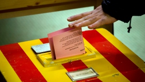 In this file photo dated Sunday, Feb. 9, 2014, A Swiss voter casts his ballot at a polling station as Swiss voters decide on a proposal to cap immigration to the Alpine republic, in Geneva, Switzerland. (AP Photo/Anja Niedringhaus, FILE)