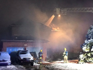 Kitchener Firefighters spray down a home on Mill Park Drive after an early morning fire. (Jeff Pickel/CTV Kitchener)