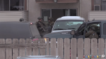 Heavily armed police respond to an alleged robbery and kidnapping that happened in Kamloops, B.C. on Feb. 14, 2018. (Castanet)