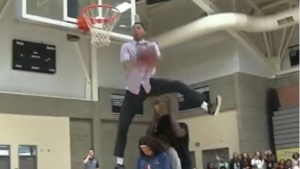 Science teacher Jonathan Clark is going viral for his videos which show him flipping and dunking over his students. He is a professional dunker and has even done motion capture for basketball video games. (jclarkthejumper/Instagram)