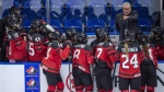 Canada head coach Perry Pearn speaks to his players as they take on Sweden during first period of 2018 Four Nations Cup preliminary game in Saskatoon, Tuesday, November 6, 2018. (THE CANADIAN PRESS/Liam Richards)