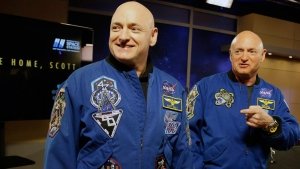 In this March 4, 2016, file photo, NASA astronaut Scott Kelly, left, and his twin Mark get together before a press conference in Houston. (AP Photo/Pat Sullivan, File)