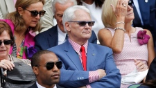 Canada's High Commissioner to London Gordon Campbell, center, sits in the Royal Box on centre court prior to the women's singles final between Eugenie Bouchard of Canada and Petra Kvitova of the Czech Republic at the All England Lawn Tennis Championships in Wimbledon, London, Saturday July 5, 2014. THE CANADIAN PRESS/AP-Sang Tan