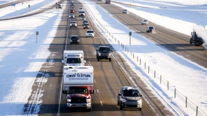 """The """"United We Roll"""" convoy of semi-trucks travels the highway near Red Deer, Alta., Thursday, Feb. 14, 2019, on its way to Ottawa to draw attention to lack of support for the energy sector and lack of pipelines.THE CANADIAN PRESS/Jeff McIntosh"""