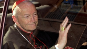 In this April 23, 2002 file photo Cardinal Theodore McCarrick of the Archdiocese of Washington, waves as he arrives at the Vatican in a limousine. (AP Photo/Andrew Medichini, file)