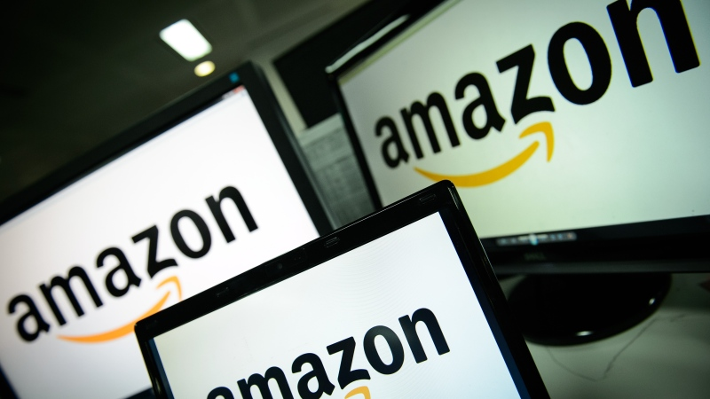 The Amazon logo is seen on computer screens. (AFP PHOTO / LEON NEAL)