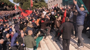 Opposition supporters try to enter the prime minister's office during an anti-government rally in capital Tirana, Albania, on Saturday, Feb. 16, 2019. (AP Photo/ Hektor Pustina)