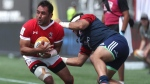 Canada's Phil Mack (left) avoids a tackle from Mike Te'o of USA during a 2019 Rugby World Cup Qualifier at Tim Horton's Field in Hamilton, Ont. on Saturday, June 24, 2017. The game finished in a 28-28 tie. THE CANADIAN PRESS/ Michael P. Hall