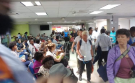 Quebec tourists gather at the terminal in the Port-au-Prince airport where a Transat plane will charter them home. (Photo by Terry Watson)