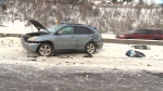 Police said a driver was struck by another vehicle after he crashed and got out to check his vehicle's damage.