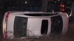A vehicle lies on its side near Highway 401 and Leslie Street following a rollover Sunday february 17, 2019.