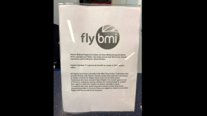 A notice informing passengers that flybmi flights have been cancelled following the collapse of the airline, at Bristol Airport in Bristol, England, Sunday, Feb. 17, 2019. (PA via AP)