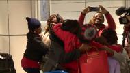 Families and friends were reunited at the arrivals gate of Montreal's Trudeau airport after they arrived home from a harrowing experience in Haiti. (CTV Montreal)