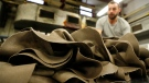 A pile of hats is seen in Borsalino's hat factory, in Spinetta Marengo, near Alessandria, Italy, Thursday, Jan. 17, 2019. Borsalino's prized felt hats are handmade by 80 workers in its Piemonte factory, many who have worked there for decades, with original machinery that use hot water and steam to transform rabbit fur into highly prized felt, that is formed into clochards, dyed and molded by hand to create the latest styles. (AP Photo/Antonio Calanni)