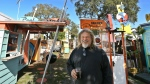 Artist Dan Painter, 56, St. Petersburg, talks about his Tiny Town outdoor art studio in St. Petersburg, Fla., Jan. 11, 2019. The town is made up of 11 art pieces he created. (Scott Keeler/Tampa Bay Times via AP)