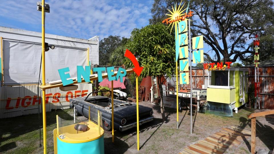 Artist Dan Painter, 56, St. Petersburg, has included a drive-in theater for his Tiny Town outdoor art studio in St. Petersburg, Jan. 11, 2019. (Scott Keeler/Tampa Bay Times via AP)