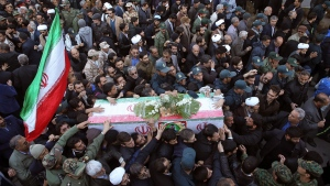 Mourners a carry flag-draped casket during a mass funeral for those killed in a suicide car bombing that targeted members of Iran's powerful Revolutionary Guard in earlier in the week, killing at least 27 people, in Isfahan, Iran, Saturday, Feb. 16, 2019. (AP Photo/Ebrahim Noroozi)