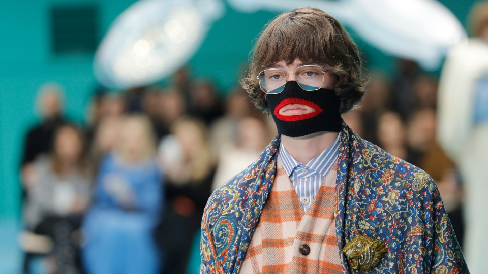 In this Feb. 21, 2018, file photo, a model wears a creation as part of the Gucci women's Fall/Winter 2018-2019 collection, presented during the Milan Fashion Week, in Milan, Italy. Gucci, which designed this face warmer, reminiscent of blackface prompted an instant backlash from the public and forced the company to apologize publicly on Wednesday, Feb. 6, 2019. (AP Photo/Antonio Calanni, File)