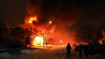 There were reports of a house explosion in southeast Calgary with fire crews arriving to find one house completely engulfed in flames early Sunday morning. (Spencer Stevens)
