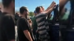 Work-release inmates in Florida were able to save a baby that had accidentally been locked in an SUV by its parents. (WFLA-TV / CNN)