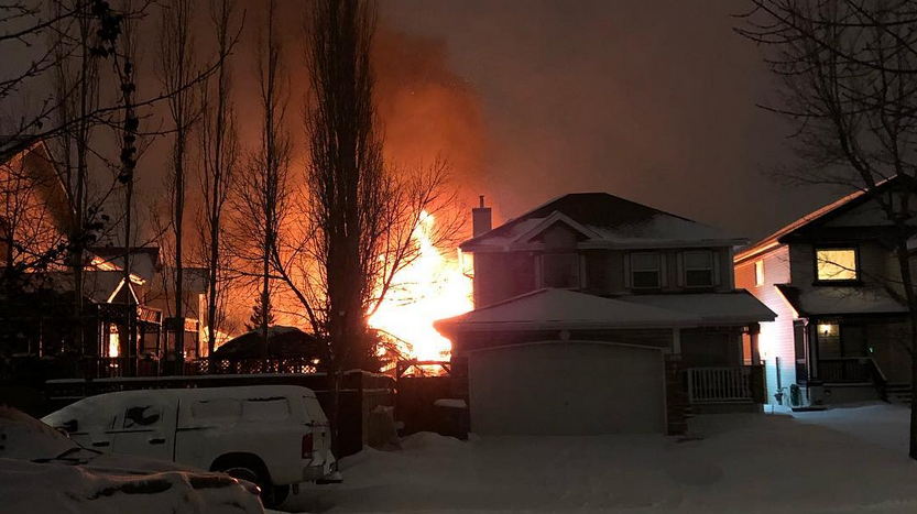There were reports of a house explosion in southeast Calgary with fire crews arriving to find one house completely engulfed in flames early Sunday morning. (jimbladon/Instagram)