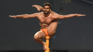 Indian gymnast performs at the Mallakhamb World Championships or 'yoga on a pole' competition in Mumbai, 2019. (PUNIT PARANJPE / AFP)