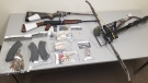 Weapons, magazines and ammunition seized by RCMP after carrying out a search warrant at a Qu'Appelle home. (Indian Head RCMP)
