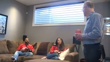 Calgary realtor Paul Ackerman hired a group of actors to play the parts of residents inside the home during a recent open house.
