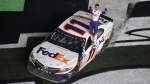 Denny Hamlin (11) celebrates after winning the NASCAR Daytona 500 auto race at Daytona International Speedway Sunday, Feb. 17, 2019, in Daytona Beach, Fla. (AP Photo/Phelan M. Ebenhack)