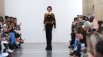 British designer Victoria Beckham acknowledges the crowd during her 2019 autumn/winter collection catwalk show at London Fashion Week. (Nicklas Halle'n/AFP)