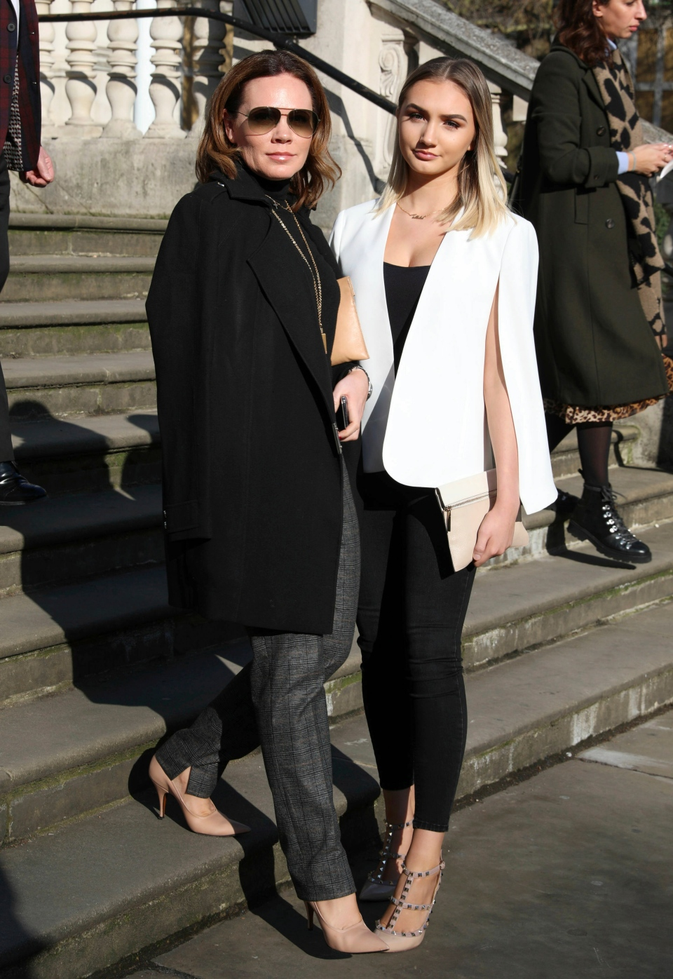 Victoria Beckham's sister Louise Adams, left, poses outside the venue for the Victoria Beckham Autumn/Winter 2019 show, during the London Fashion Week at Tate Britain in London, Sunday Feb. 17, 2019. (Isabel Infantes/PA via AP)