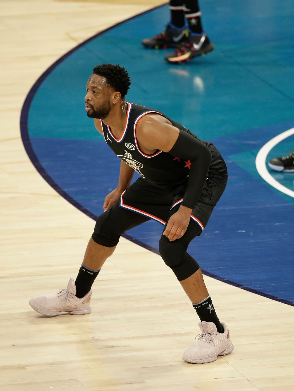 Team LeBron's Dwayne Wade, of the Miami Heat, works against Team Giannis during the second half of an NBA All-Star basketball game, Sunday, Feb. 17, 2019, in Charlotte, N.C. (AP Photo/Gerry Broome)