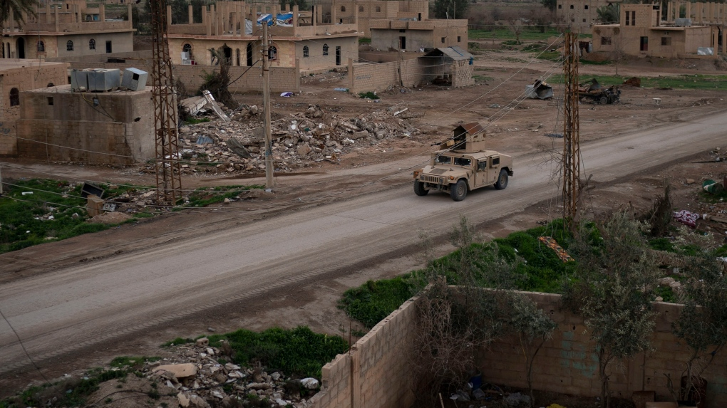 Troops celebrate as U.S.-backed force seizes ISIS camp in Syria