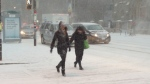 It's a snowy walk to work at King and Simcoe in downtown Toronto as extreme cold and flurries swept through the city, Tuesday, Jan. 22, 2013. (George Stamou / CTV Toronto)