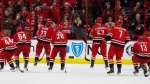 Carolina Hurricanes skate toward the crowd during an on ice celebration following their 2-1 win over the New Jersey Devils at an NHL hockey game, Sunday, Nov. 18, 2018, in Raleigh, N.C. (THE CANADIAN PRESS/AP, Karl B DeBlaker)