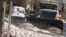 Crews will work on clearing priority two routes including; collector roads, major community access roads and bus routes. (File Photo)