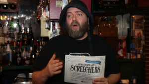 Brian Day displays the official certificate that participants receive as he officiates at a 'Screech In at Christian´s Pub' on Wednesday February 13, 2019 in St. John´s NL. THE CANADIAN PRESS/Paul Daly