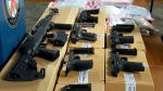 "Toronto police display a number of firearms seized during a series of search warrants connected to ""Project Moses"" on Feb. 18, 2019."