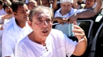 """FILE - In this Dec. 12, 2018 handout file photo released by Agencia Brasil, spiritual healer Joao Teixeira de Faria, better known as John of God, arrives to his """"spiritual house,"""" Casa de Dom Inacio, in Abadiania, Brazil. For over 40 years, de Faria drew people from all over the world to his """"spiritual house,"""" offering treatment for everything from depression to cancer.(Marcelo Camargo/Agencia Brasil via AP File)"""