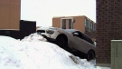 Porsche mounts snowbank in Mississauga