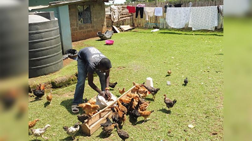 Stewart Skinner captured this photo of a farmer in Kenya working with poultry.