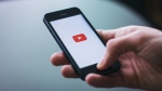 YouTube on a mobile phone. (freestocks.org / Pexels)