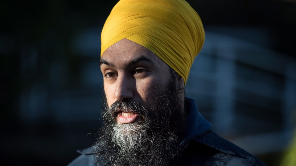 NDP Leader Jagmeet Singh is interviewed while door knocking for his byelection campaign, in Burnaby, B.C., on January 12, 2019. THE CANADIAN PRESS/Darryl Dyck