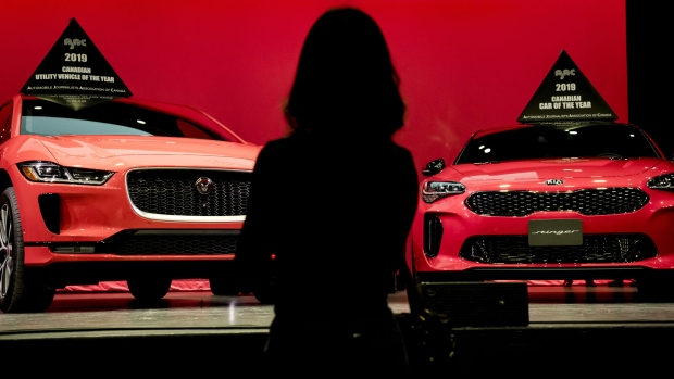The electric powered Jaguar I-Pace (left) and the Kia Stinger were awarded 2019 Utility Vehicle and Car of the Year by the Automobile Journalists Association of Canada during an event at the Canadian International Auto Show in Toronto on Thursday, February 14, 2019. (The Canadian Press / Christopher Katsarov)
