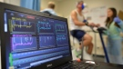 A laptop computer monitors a patient's heart function as he takes a stress test while riding a stationary bike in Augusta, Ga. on Aug. 27, 2014. (AP Photo/The Augusta Chronicle, Michael Holahan)