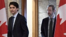 Prime Minister Justin Trudeau leaves his office with his principal secretary Gerald Butts to attend an emergency cabinet meeting on Parliament Hill in Ottawa on Tuesday, April 10, 2018. THE CANADIAN PRESS/Justin Tang