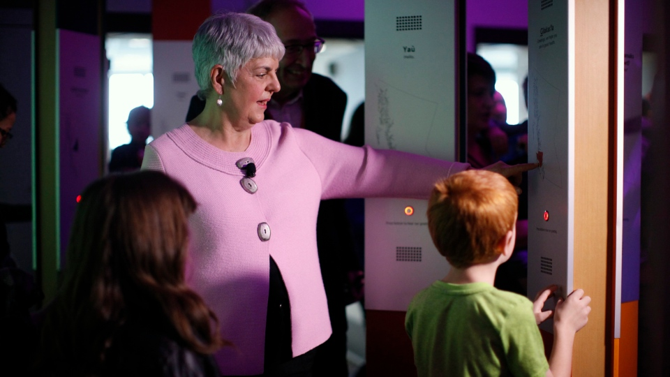 Finance Minister Carole James tours the Our Living Languages exhibit at the Royal B.C. Museum in Victoria, B.C., on Monday, February 18, 2019. THE CANADIAN PRESS/Chad Hipolito