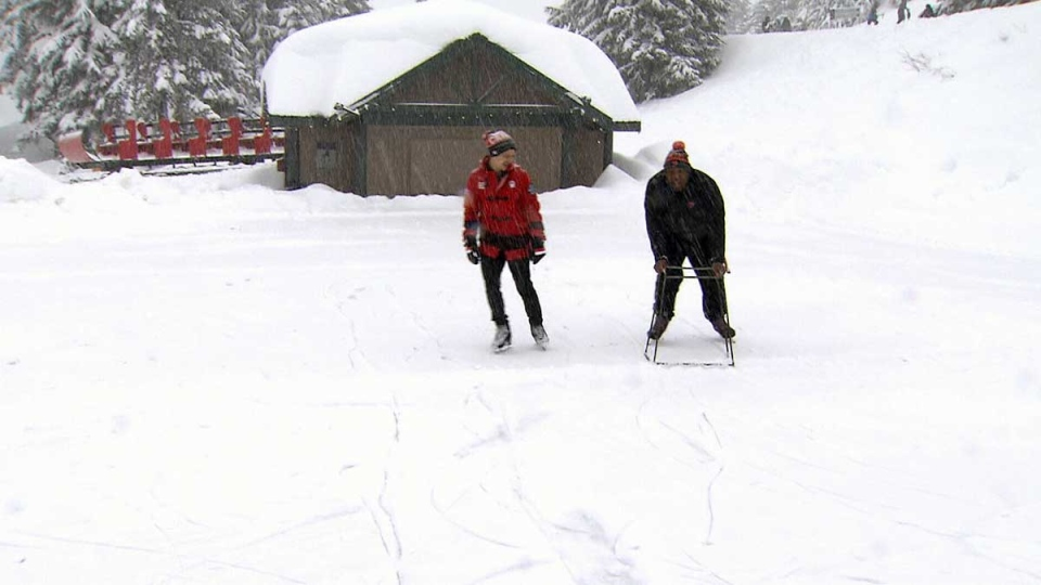 Patrick Chan (left) teaches DeVone Claybrooks how to skate at Grouse Mountain.