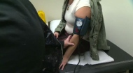 A nurse practitioner checks blood pressure