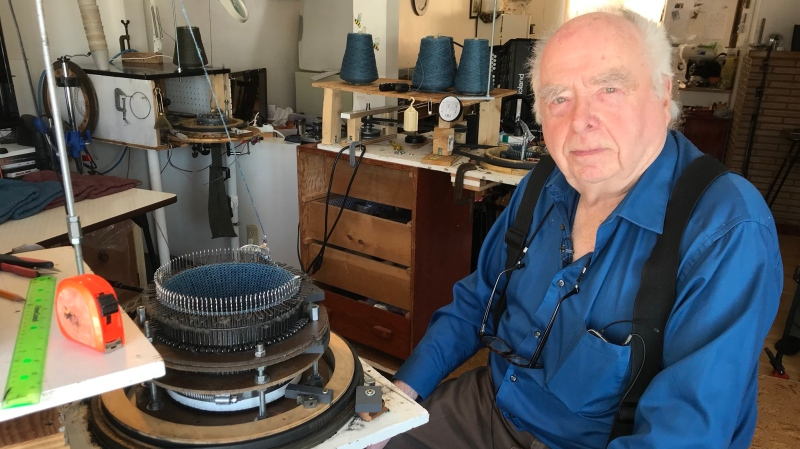 Bob Rutherford, 91, with one of his knitting machines. (Stephanie Villella/CTV Saskatoon)